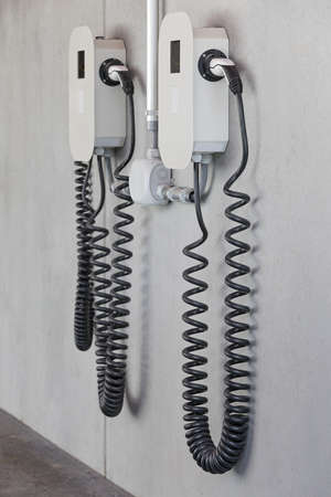 electric charger with cables on concrete wall