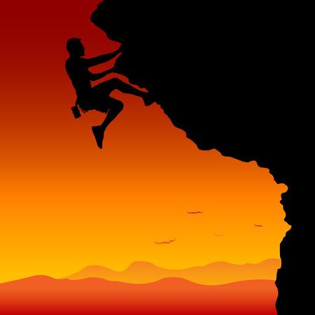 석양에 산을 등반하는 남자.