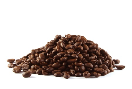 Pile of coffee beans shot on a white background.