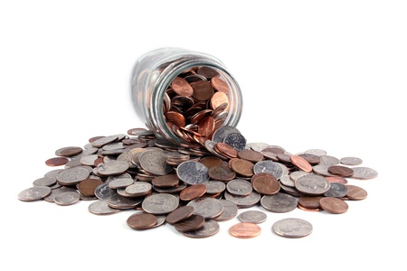 nickle: U.S. coins spilled from a jar on white. Stock Photo