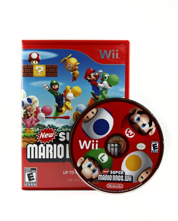 wii: Springfield, Missouri - March 17, 2011: An isolated studio shot of the popular video game New Super Mario Bros. Wii for the Nintendo Wii gaming system. Editorial