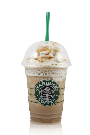 Springfield, Missouri - March 5, 2011: An isolated studio shot of a cup of Starbucks Caramel Frappuccino. Editorial