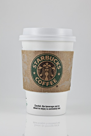 cup: Springfield, Missouri - March 6, 2011: A studio shot of a cup of Starbucks Coffee.