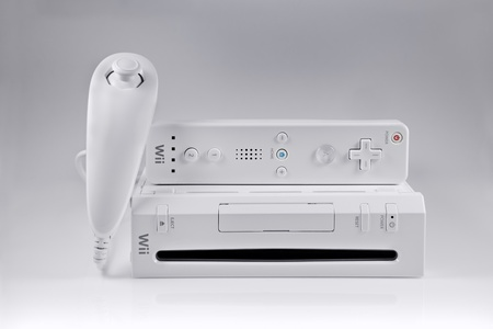 wii: Springfield, Missouri - February 18, 2011: A studio shot of the Nintendo Wii video game system with the nunchuk and controller set. Editorial