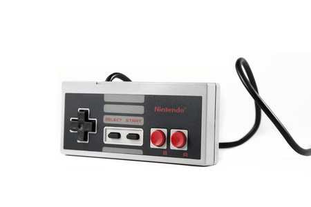 Springfield, Missouri - January 9, 2011: A studio shot on a solid white background of a Nintendo Entertainment System controller.