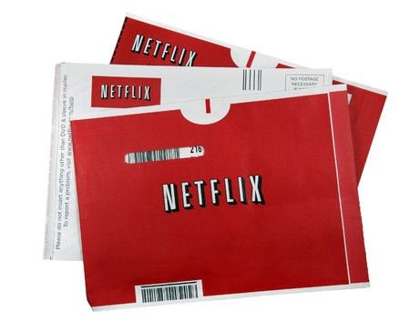A studio shot of 3 Netflix movie sleeves. Netflix is the worlds leading internet subscription service for movies and TV shows.
