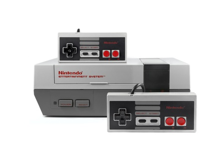 Springfield, Missouri - January 3, 2011: A studio shot on a solid white background of a Nintendo Entertainment System and two Nintendo controllers.