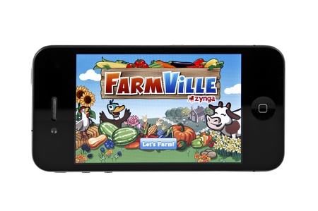 editorial: Springfield, Missouri - March 15, 2011: A close up studio shot of the popular game FarmVille on the iphone 4.