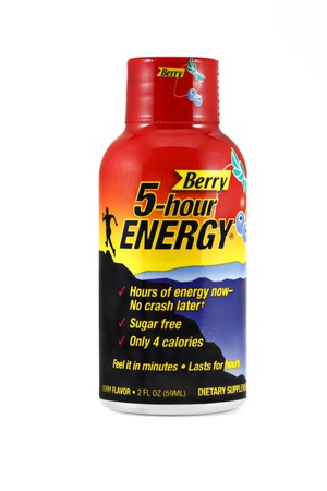 energy drinks: Springfield, Missouri - March 6, 2011: An isolated studio shot of a single shot of Berry flavored 5-hour Energy,  a liquid energy shot that can help you feel sharp and alert for hours containing a blend of B-vitamins, amino acids, and nutrients.