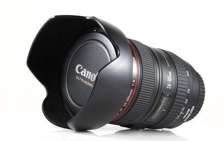 Springfield, Missouri - February 13, 2011: An isolated studio shot of a Canon 24-105mm f/4L IS USM standard zoom lens.