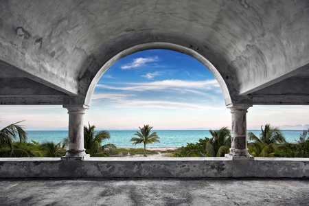 A beautiful view of the ocean from inside an old abandoned mansion. photo