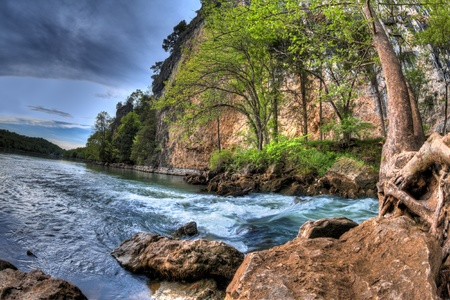 A High Dynamic Range photo of a rushing natural spring flowing into the lake of the ozarks in Missouri. Stock Photo