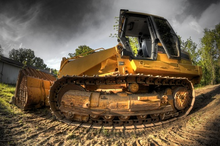 A High Dynamic Range fisheye photo of a bulldozer at a construction site.