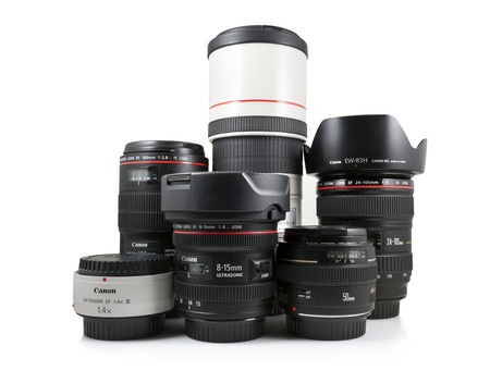 Springfield, Missouri, USA - April 25, 2012: A studio shot on a white background of a collection of Canon lenses distributed by Canon inc.
