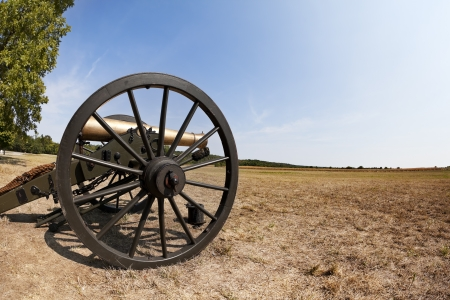 Civil War cannon in an open field.