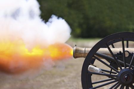 Civil War cannon fireing at a civil war re-enactment.