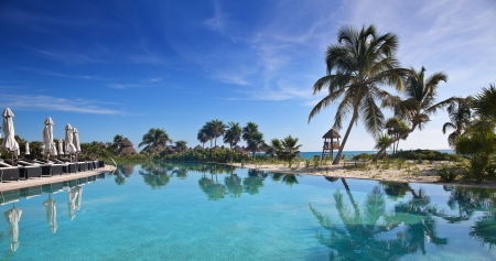 Poolside with the ocean in the background at a tropical resort. Stock Photo - 17170841