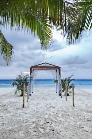 archway: Beach wedding archway on a tropical resort.