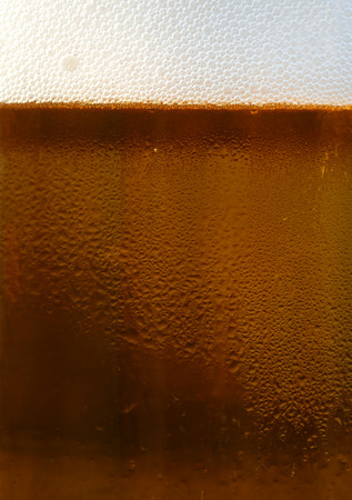 Dark draft beer in a glass mug with condensation Foto de archivo