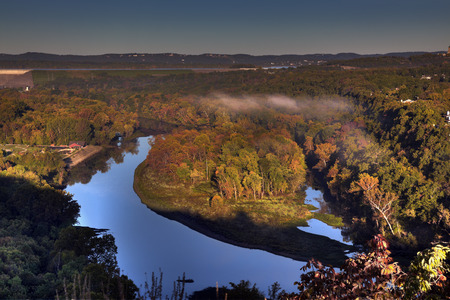 Scenic overlook at sunrise in Branson, Missouri showing the water reservoir from the Table Rock Lake Dam and colorful fall foliage