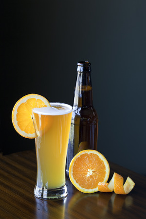 Glass of Belgium Wheat Ale with an orange slice