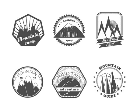 A collection of decorative round and polyangular snowy mountains summer camp labels isolated vector illustration Illustration