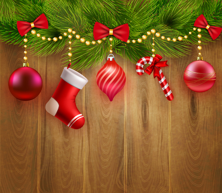 moños de navidad: Christmas festive template with green fir twigs red balls candy sock bows on wooden background illustration
