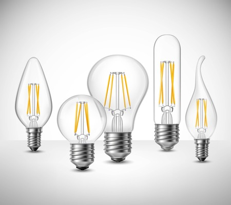 Realistic set of filament led lightbulbs on grey surface vector illustration Illustration