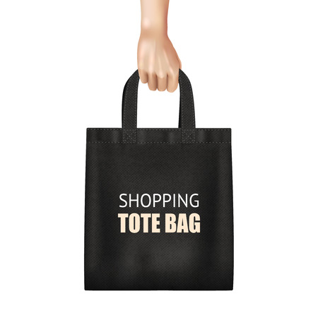 Hand holding fashionable black canvas shopping tote bag with lettering realistic close up view vector illustration