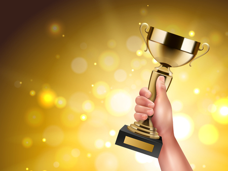 Trophy in hand realistic composition with human wrist holding golden cup on blurry background with flares vector illustration