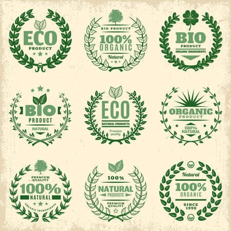 Vintage green eco product labels set with inscriptions and decorative natural floral wreathes isolated vector illustration Vetores