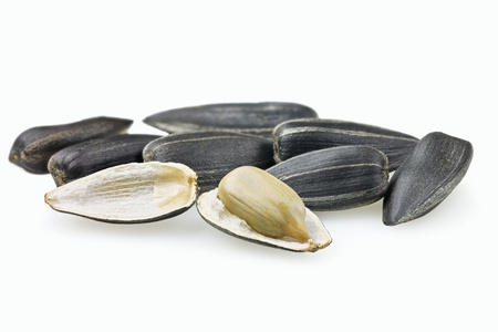black seeds: Sunflower seed open on white background Stock Photo