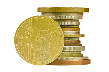 Coin pile with fifty cent euro isolated on white background photo