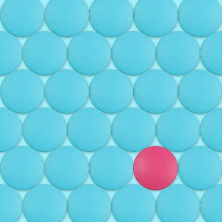exception: Abstract background with red pill between blue pills