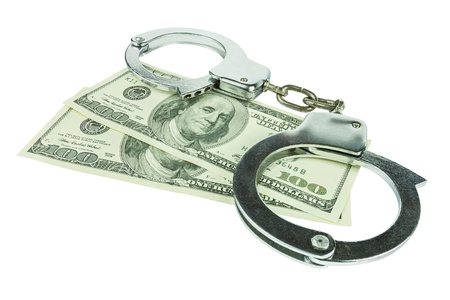 Handcuffs with money isolated in white background photo
