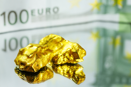 Golden nuggets on mirror with one hundred euro banknote Stock Photo