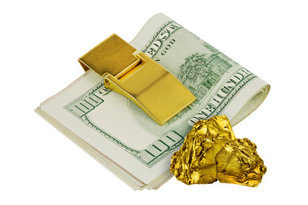 Golden nuggets isolated on white background wit one hundred dollars banknotes in golden money clip Stock Photo