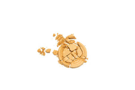 grooming product: Gold beige eye shadow crushed cosmetic  isolated on white background.