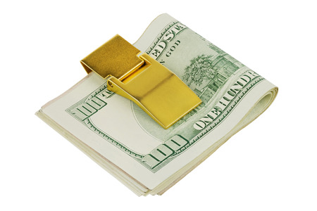 One hundred dollars banknotes in golden money clip isolated Stock Photo