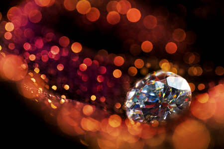 joyas de oro: Glitter and glow soft multi colored  bokeh shining with big natural jewelry precious stone. Dark abstract dreamy wunderful sparkle background