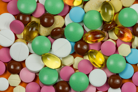 Different medical colorful pills background close up Stock Photo