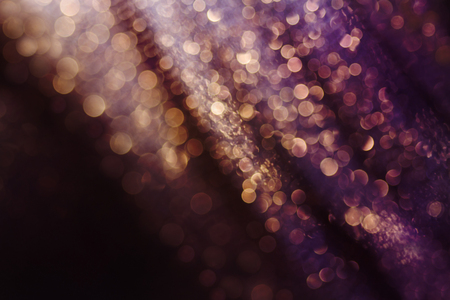 joyas de oro: Glitter and glow soft multi colored bokeh shining . Dark abstract dreamy wunderful sparkle background.