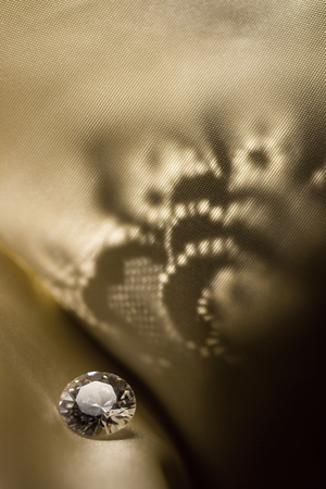 Amazing diamond on vintage pattern background with soft light.