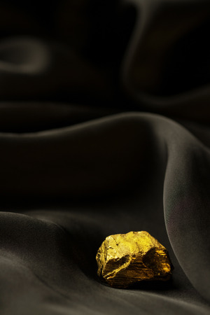 Golden bar on black soft background Imagens
