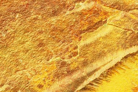 Golden grunge texture of golden nugget surface. Golden background of natural surface