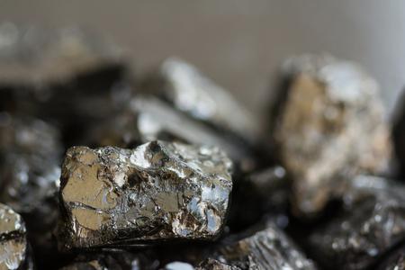 Black coal mine close-up with soft focus. Anthracite coal bar on dark background Reklamní fotografie