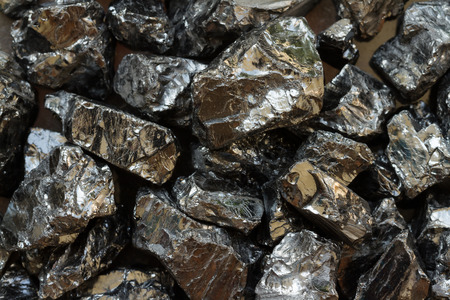 Natural black coal bars for background. Industrial coal nuggets close up