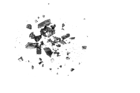 Pile of black coal bars isolated on white background