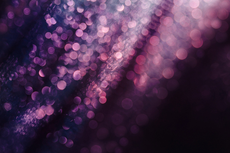 Glitter and glow soft multi colored bokeh shining . Dark abstract dreamy wunderful sparkle background.