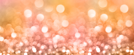 Colored abstract blurred light glitter background